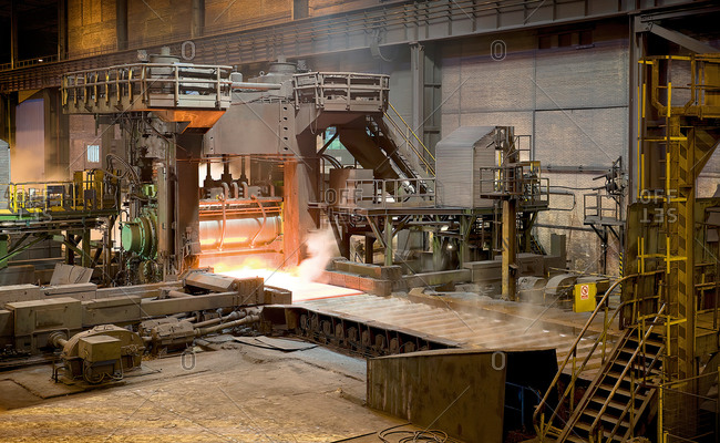 Burning forge inside of spacious metal workshop ready to produce metal structure in industrial building of modern factory in Asturias