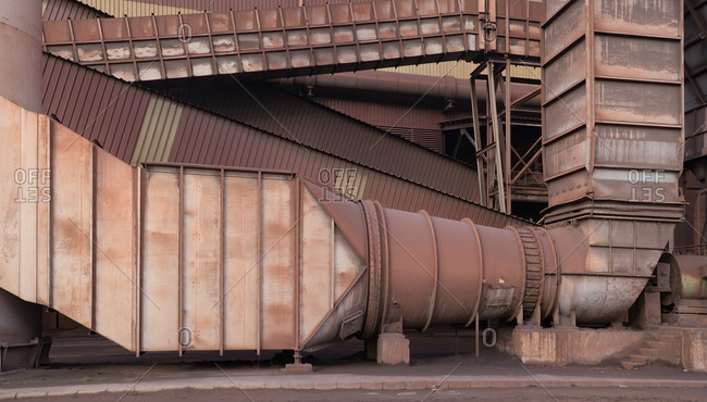 Exterior of steel factory with metal pipes placed outside  building in Asturias