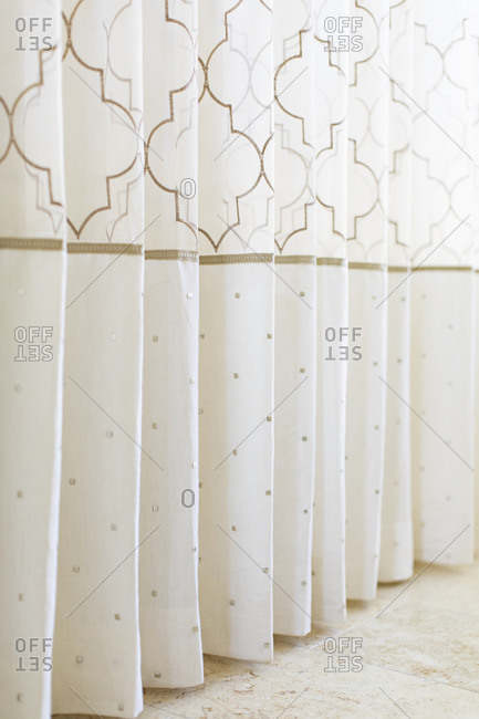 White and gold colored shower curtain
