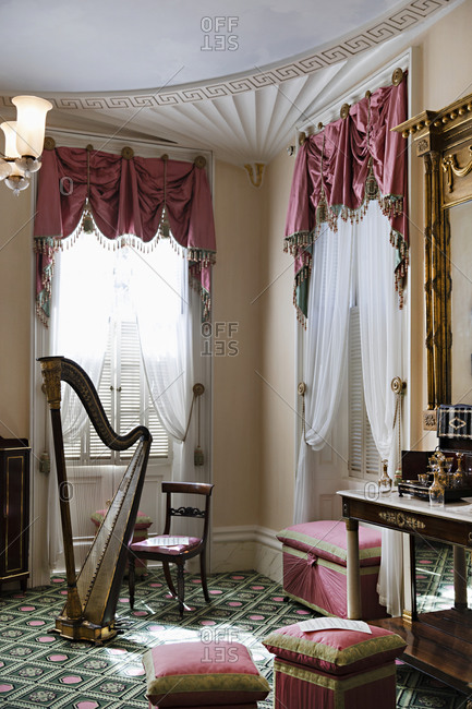 Savannah Georgia - March 7, 2019: Interior of a home with pink drapes and a harp