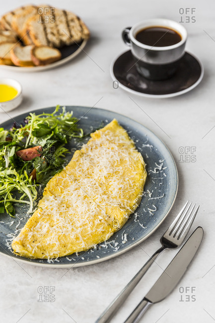 Cheese omelet with coffee