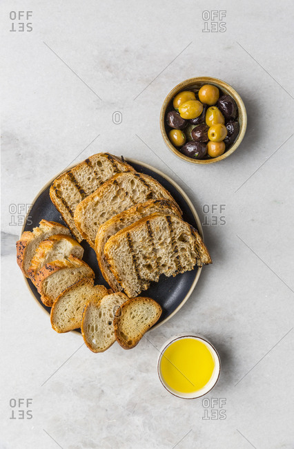 Artisan bread with olives and olive-oil