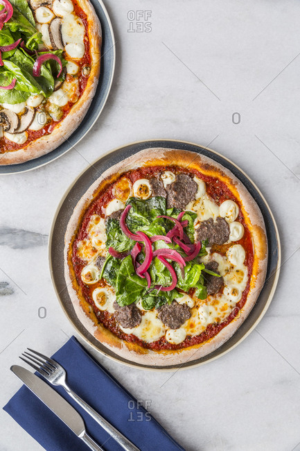 Artisan pizzas on the marble table