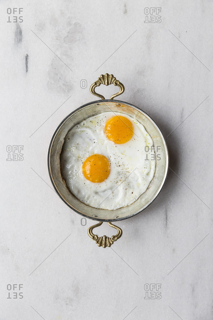 Fried eggs in an antique skillet