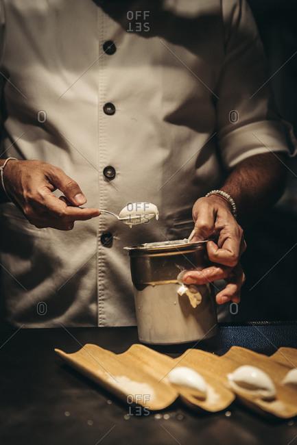 Professional chef preparing ice cream dessert