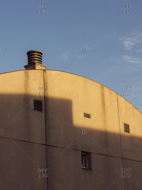 Side of a concrete building with arched roof