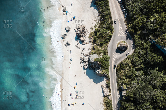 Aerial View Of Cars Driving On Coastal Road Through Forest Along Shore Of Tropical Beach In Rio De Janeiro, Brazil