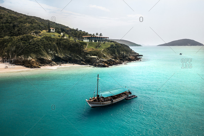 September 1, 2019: Aerial View Of Sail Boat Anchored Along The Shore Of Tropical Island Beach In Arraial Do Cabo, Brazil