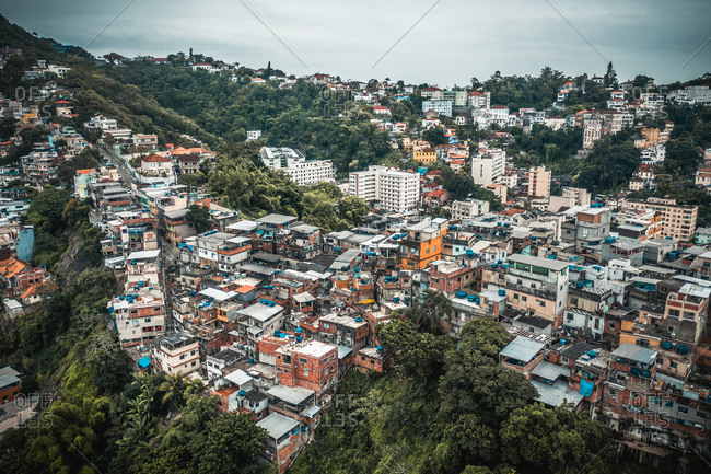November 18, 2019: Aerial View Of Compact Houses In The Santo Amaro Favela Surrounded By Lush Forest In Rio de Janeiro, Brazil