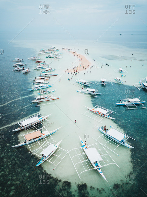 May 26, 2019: Aerial view of a sandbar with boats around in Panglao, Bohol, Philippines