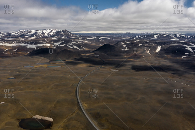 Aerial view of a road surrounded by mountains in Eastern Region, Iceland