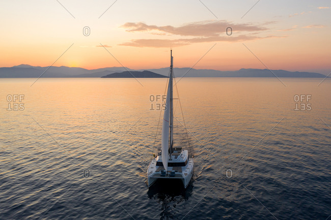 October 2, 2019: Aerial view of a yacht at sunset in Saronic Gulf, Greece