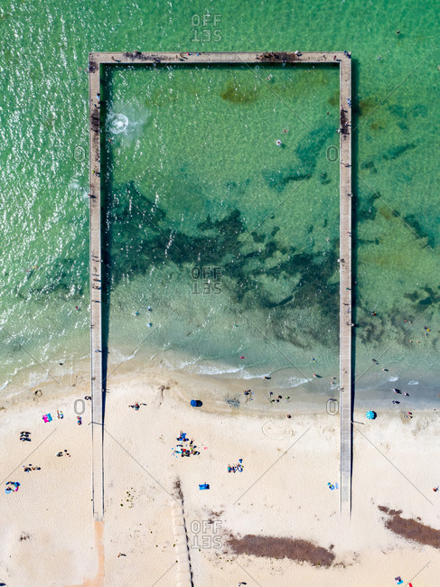 Aerial view of a rectangle jetty where kids learn to swim in the sea water, in Busselton, Western Australia, Australia