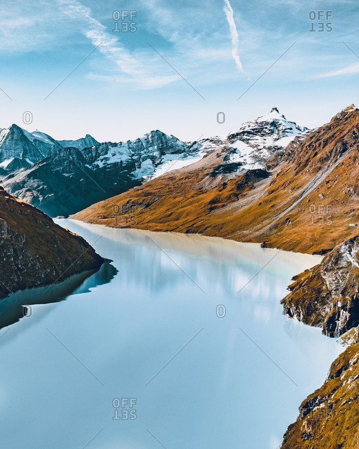 """Aerial view of the """" Lac des Dix """" and some mountains summits covered with snow, in Wallis Switzerland"""