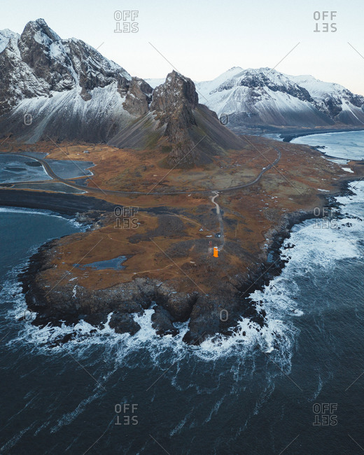Aerial view of snowy mountains on shoreline in North Atlantic Ocean, Iceland