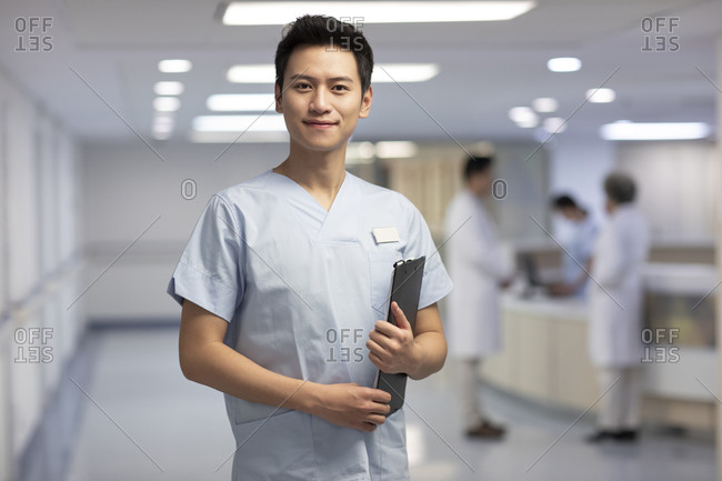 Portrait of young Chinese male nurse