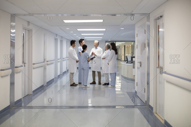 Chinese doctors talking in hospital corridor