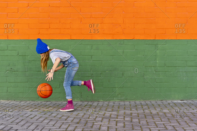 Young girl playing basketball- dribbling
