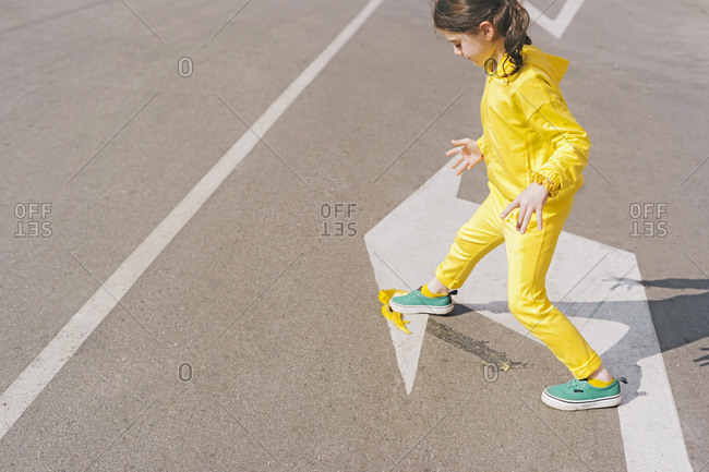 Girl stepping on banana peel on a street