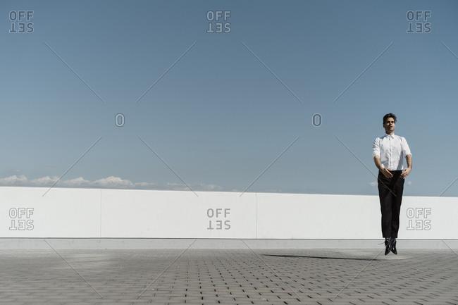 Ballet dancer practicing on roof terrace
