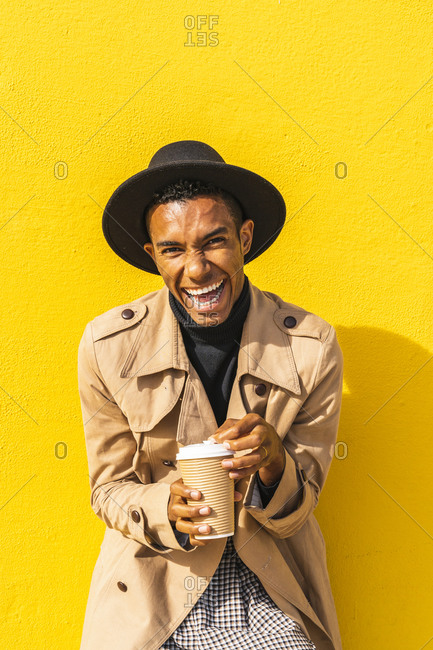 Young man enjoying his take-out coffee