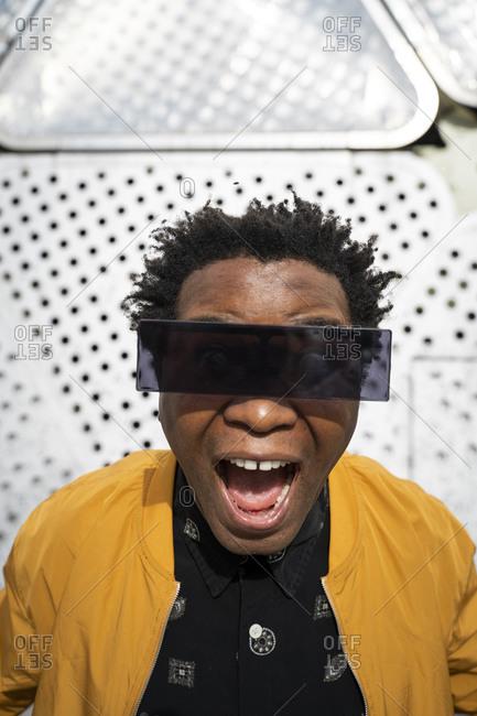 Portrait of performing mature man wearing modern sunglasses- Barcelona- Spain