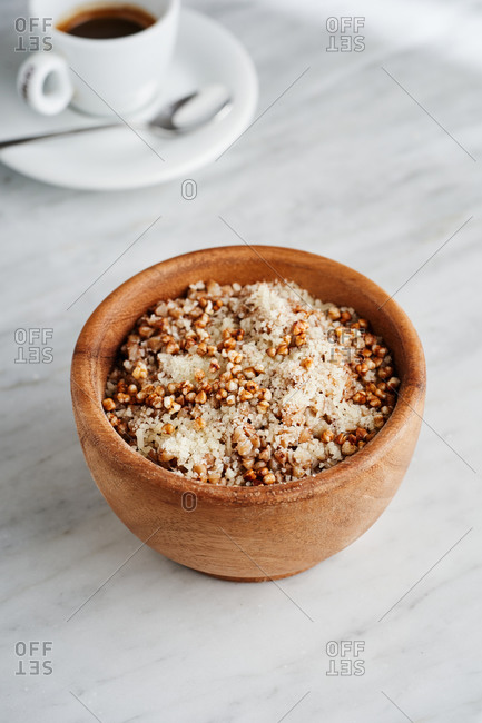 Beautiful breakfast of buckwheat served with grated parmesan cheese and a cup of espresso