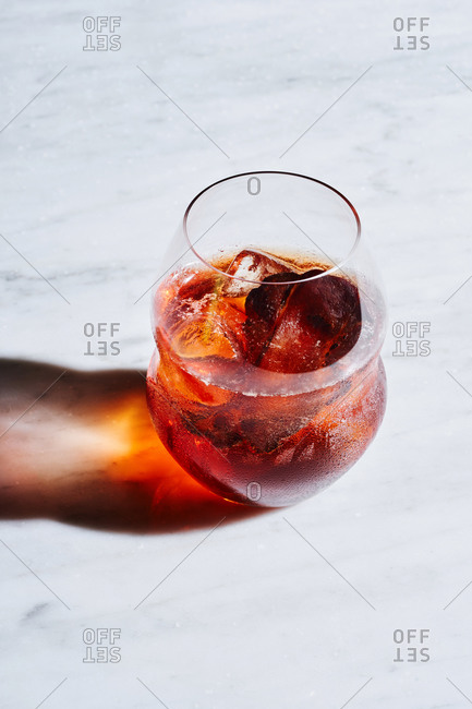 Negroni - popular Italian cocktail, made of gin, red vermouth and Campari, garnished with orange peel.