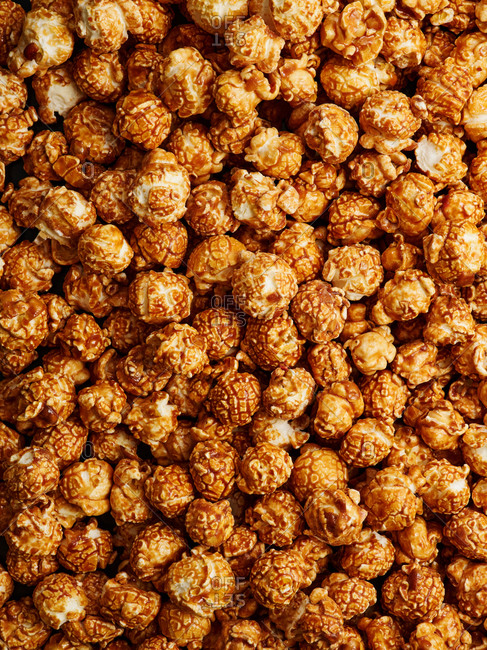 Top view of scattered gourmet caramel popcorn (background and texture)