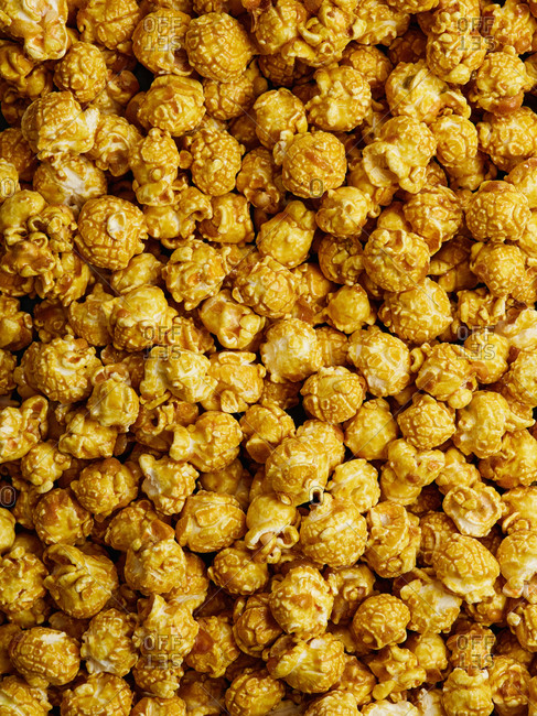 Top view of scattered yellow banana flavored popcorn
