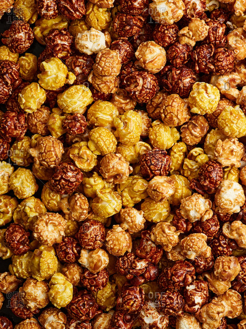 Assorted flavors of sweet popcorn - caramel, chocolate and banana