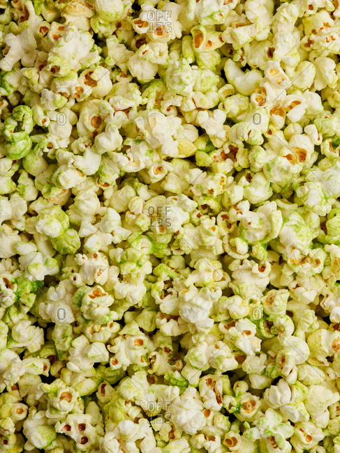 Savory and spicy green wasabi flavored popcorn