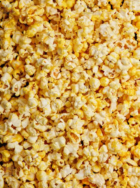 Close up view of savory and salty cheddar cheese flavored popcorn texture