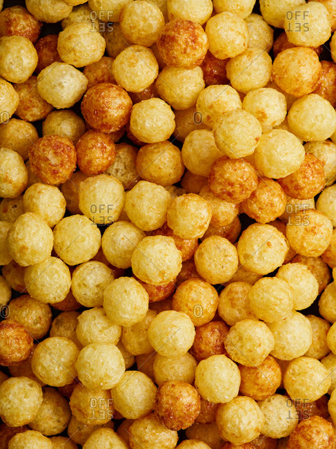 Close up view of caramel flavored puffed corn balls
