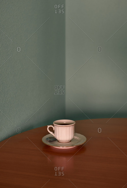 Coffee cup on a corner table. Conceptual image