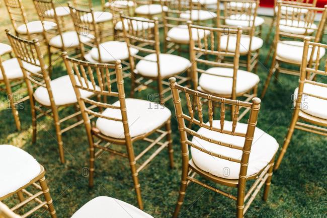 Gold chairs at outdoor garden wedding