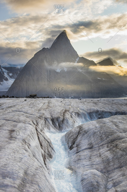 Glacier meting, creating river through ice below Mt. Loki