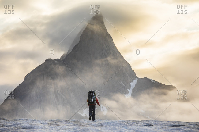 Mountaineer prepares for a day of climbing on Baffin Island.
