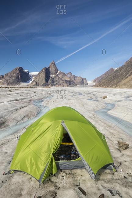 Green tent perched on glacier below Mt. Loki, Baffin Island.