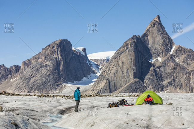 Climbers relaxing at basecamp on glacier below Mt. Loki, Baffin Island