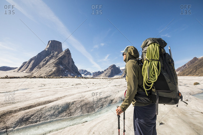Backpacker looks up towards his next objective, Mount Asgard, Canada.