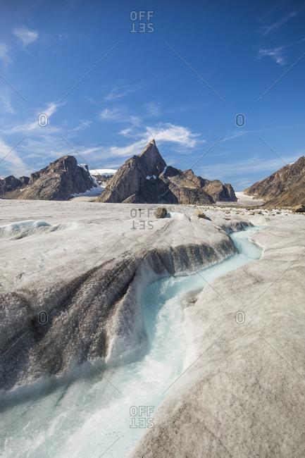 River meanders through a glacier below Mount Loki, Baffin Island.