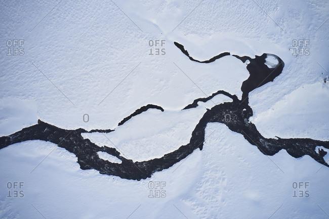 Frozen river in mountainous area in winter