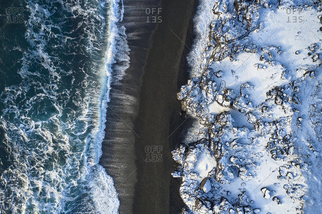 Sea waves rolling over seashore in winter