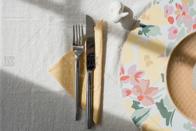 cutlery and napkin on a decorated dinner table in summer and spring