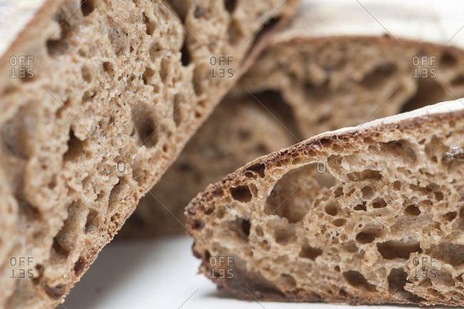 sliced sourdough bread on white background
