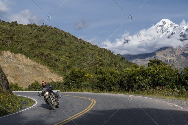Man driving his touring motorbike down from the Abra de Malaga pass