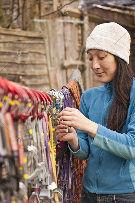 woman hanging up climbing gear to dry out