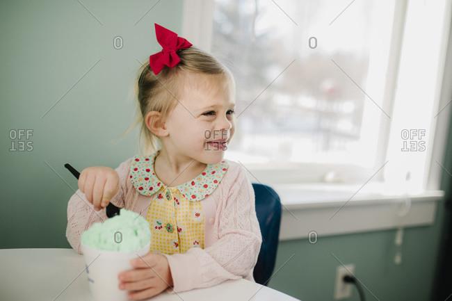 Girl eating ice cream happy