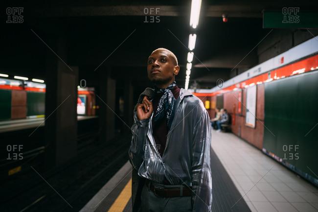 Stylish man on subway platform, Milan, Italy